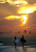 Adult Boogie Boarders At Sunset