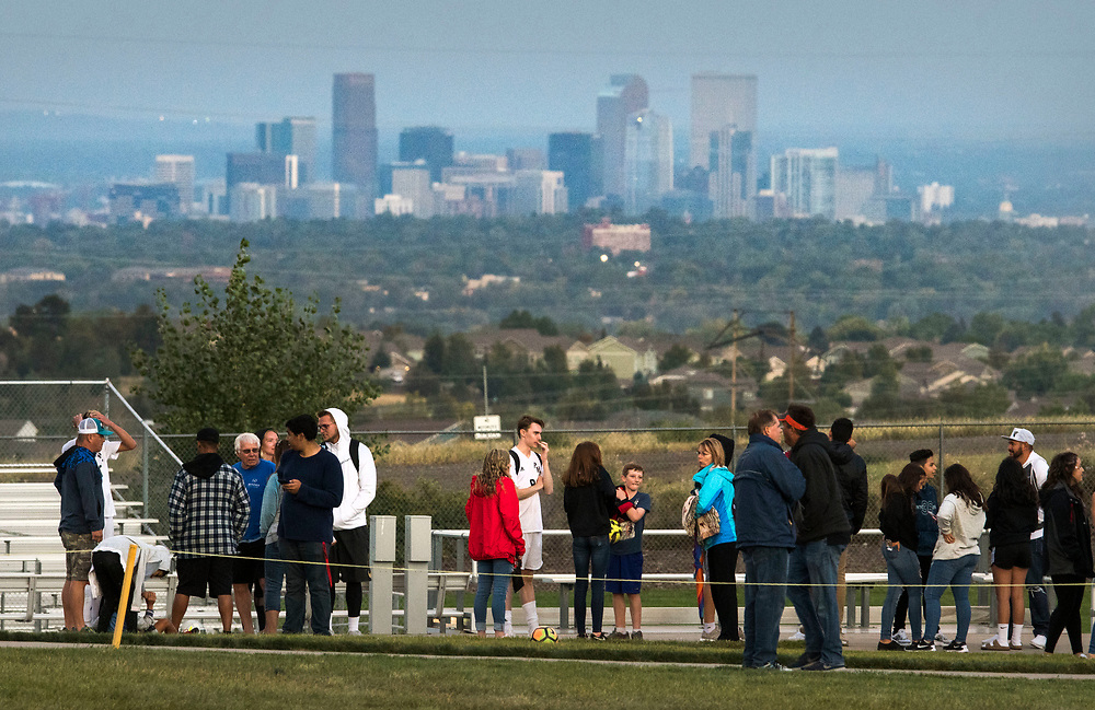 ARVADA - SEPT. 22: With the Denver skyline in the distance, spectators await the start of the high school varsity football 5A nonconference matchup between Valor Christian and Pomona at the North Area Athletic Complex. (Photo by Andy Colwell/ Special to The Denver Post)