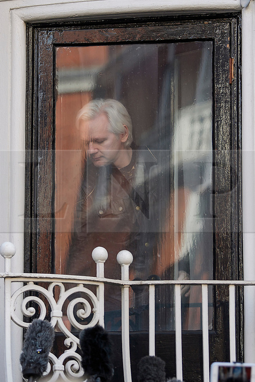© Licensed to London News Pictures. 19/05/2017. London, UK. JULIAN ASSANGE exiting a window to speak from the Ecuadoran embassy in London where the Wikileaks founder has been living since 2012. Today the Swedish authorities have announced that they are dropping their investigation into rape allegations against him. Photo credit: Ben Cawthra/LNP