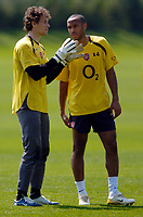 Photo: Richard Lane.<br />Arsenal Training Session. The Barclays Premiership. 11/05/2006.<br />Jens Lehmann (L) talks tactics with Thierry Henry in training.