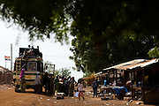 Passengers board public transport in the village of Tali, northern Ghana on Tuesday March 24, 2009..