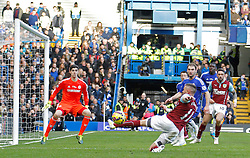 Burnley's Michael Kightly stretches for the ball - Photo mandatory by-line: Mitchell Gunn/JMP - Mobile: 07966 386802 - 21/02/2015 - SPORT - Football - London - Stamford Bridge - Chelsea v Burnley - Barclays Premier League