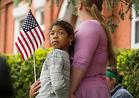Families joined along Main Street and the Meredith Public Library in remembrance of those gone during the Memorial Day services and parade on Monday morning.  (Karen Bobotas/for the Laconia Daily Sun)