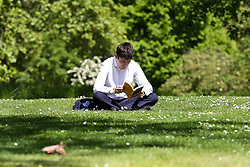 © Licensed to London News Pictures. 14/05/2019. London, UK. A man reads a book on a warm and sunny day London's St James's Park. Temperatures are set to reach 19C in the capital and potentially higher in the some parts of the UK. Photo credit: Dinendra Haria/LNP