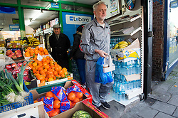 © Licensed to London News Pictures. 28/11/2015. London, UK. Labour Party leader JEREMY CORBYN  carrying coffee and newspapers while leaving a corner shop next to his home in Islington, north London this morning (Sat). Jeremy Corbyn has come under pressure from his own party over a potential vote on UK military involvement in Syria. Photo credit: Ben Cawthra/LNP