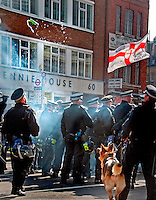 Police dogs being used  for street riot during EDL march in London