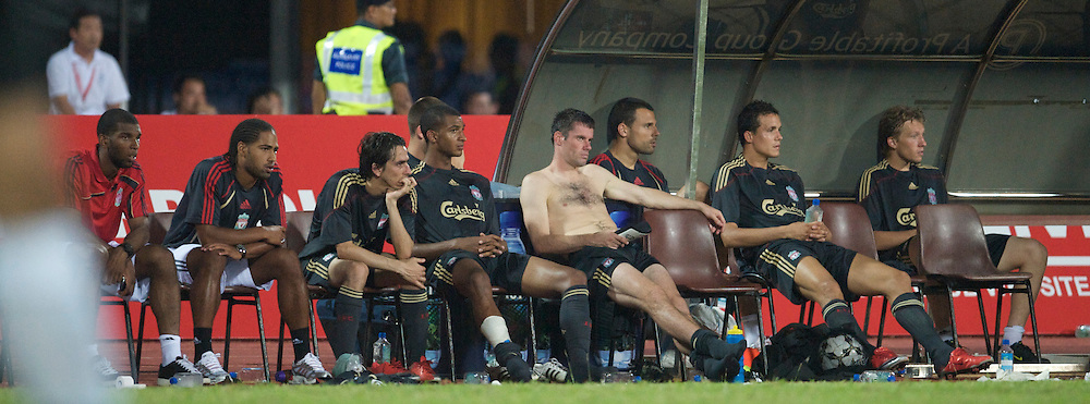 SINGAPORE, SINGAPORE - Sunday, July 26, 2009: Liverpool players on the bench during a preseason friendly at the Singapore National Stadium. L-R: Damien Plessis, Glen Johnson, Yossi Benayoun, David Ngog, Jamie Carragher, goalkeeper Diego Cavalieri, Philipp Degen, Lucas Leiva. (Pic by David Rawcliffe/Propaganda)