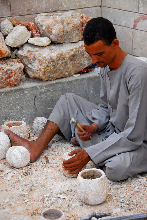 An Egyptian man works on a piece of alabaster in Aswan, Egypt.<br /> <br /> Editorial or Personal Use Only.<br /> No model release.