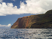 View of Makaha Ridge from the Pacific Ocean, off of the Na Pali Coast, Kauai, Hawaii, USA.