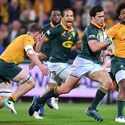 Jan Serfontein of South Africa tries to evade Michael Hooper, Captain of Australia