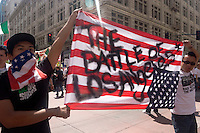 Protesters Hold Up an Upside Down U.S. Flag at the May Day illegal Immigration March, Downtown Los Angeles, California