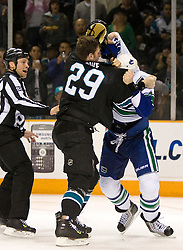 April 8, 2010; San Jose, CA, USA; San Jose Sharks left wing Ryane Clowe (29) fights with Vancouver Canucks defenseman Aaron Rome (29) during the second period at HP Pavilion.  San Jose defeated Vancouver 4-2. Mandatory Credit: Jason O. Watson / US PRESSWIRE