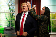 UNITED KINGDOM, London: 18 January 2017 The wax figure of President Elect Donald J. Trump gets the final touches by Jemma Sim in the Madame Tussauds London's Oval Office section at its unveiling today. The London wax figure is one of four Trump figures created by Madame Tussauds globally, the others are in Washington D.C, New York and Orlando. Rick Findler / Story Picture Agency