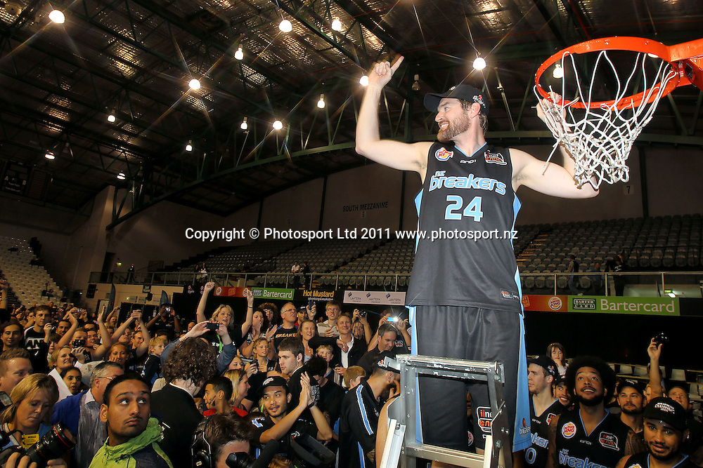 Breakers' Dillon Boucher cuts the net. iinet ANBL, Grand Final Game 3, New Zealand Breakers vs Cairns Taipans, North Shore Events Centre, Auckland, New Zealand. Friday 29th April 2011. Photo: Anthony Au-Yeung / photosport.co.nz