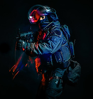 one soldier police swat tactical forces man studio shot  isolated on black background