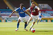 Brighton and Hove Albion midfielder Yves Bissouma (8) goes past Erik Pieters of Burnley (23)   during the Premier League match between Burnley and Brighton and Hove Albion at Turf Moor, Burnley, England on 26 July 2020.