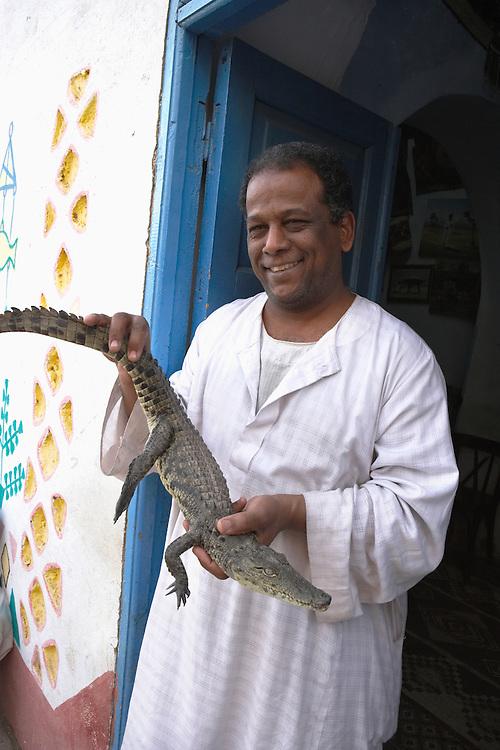 Man and crocodile, Nubian village, Aswan, Egypt
