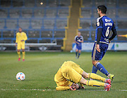 Hamza Bencherif (Halifax) clears the ball while Gavin Rothery (Guiseley) rolls head over heels after the challenge during the Conference Premier League match between FC Halifax Town and Guiseley at the Shay, Halifax, United Kingdom on 5 December 2015. Photo by Mark P Doherty.