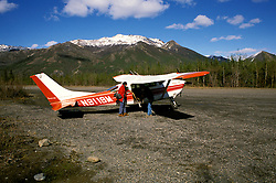 Alaska: Flying in a small plane around Mt. McKinley. Photo akflyi101..Photo copyright Lee Foster, 510/549-2202,  lee@fostertravel.com, www.fostertravel.com