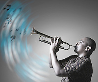 Man playing trumpet and making music