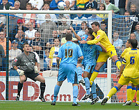 Photo: Ed Godden.<br />Coventry City v Leeds United. Coca Cola Championship. 16/09/2006. Leeds' Sean Gregan (#8) leaps high to challenge the Coventry defence.