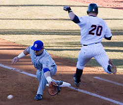 Virginia Cavaliers outfielder Brandon Guyer (20) beat a throw to first to get on base against Delaware.  The Virginia Cavaliers Baseball Team defeated the Delaware Blue Hens 11-2 in the first of a three game series at Davenport Field in Charlottesville, VA on March 2, 2007.
