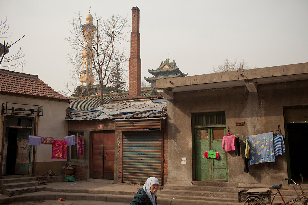 The minaret of a mosque rises above a neighborhood in Zhengzhou the captial of Henan province.<br /> In central China, most Muslims support the female mosques, but there is some resistance closer to China's border with Pakistan and Afghanistan, closer to the harder-line Wahhabi and Salafi influences.