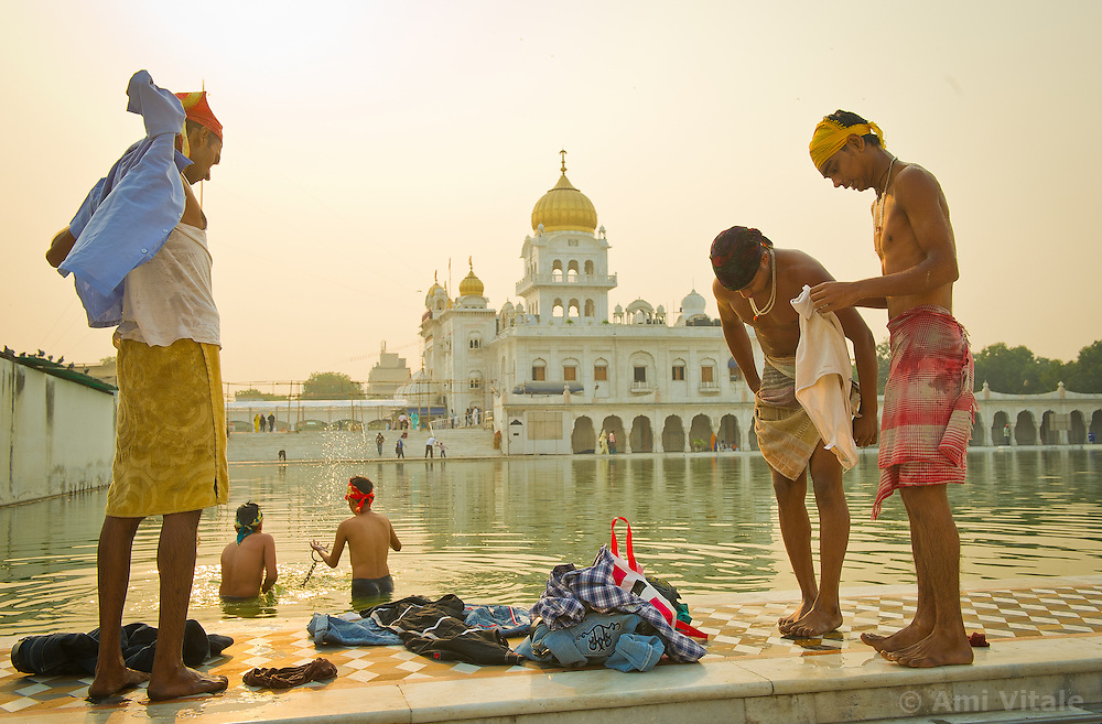Sikhs bath in the early morning at the Gurdwara Bangla Sahib  in New Delhi, India. A Gurdwara meaning the Gateway to the Guru, is the place of worship for Sikhs, the followers of Sikhism.