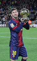 16.01.2013 Barcelona, Spain. Leo Messi with offer to suporters ballon d'or at Camp Nou