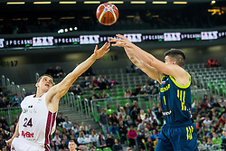 Matic Rebec of Slovenia  and Andrejs Grazulis of Latvia during basketball match between National teams of Slovenia and Latvia in Round #10 of FIBA Basketball World Cup 2019 European Qualifiers, on December 2, 2018 in Arena Stozice, Ljubljana, Slovenia. Photo by Grega Valancic