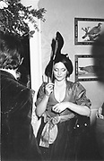 countess of Lichfield with shoe on a stick party given by Mrs. H. Mazandi 1982© Copyright Photograph by Dafydd Jones 66 Stockwell Park Rd. London SW9 0DA Tel 020 7733 0108 www.dafjones.com
