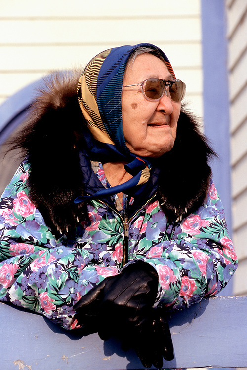 Amy Okpeaha stands outside the Presbiterian Church while waiting for the service in I&ntilde;upiaq to begin. The church is over a hundred years-old.<br /> <br /> May 18, 19:23