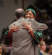 Samiya Jene'e Savannah gets a hug from Sharpstown principal Robert Gasparello during graduation ceremonies at Delmar Fieldhouse, August 17, 2013. Savannah completed her course work at Sharpstown High School in 1996 but did not pass the standard exam required to graduate. She eventually got a GED and went to college. She decided to complete the required test and walk at graduation to have a diploma like her oldest son.