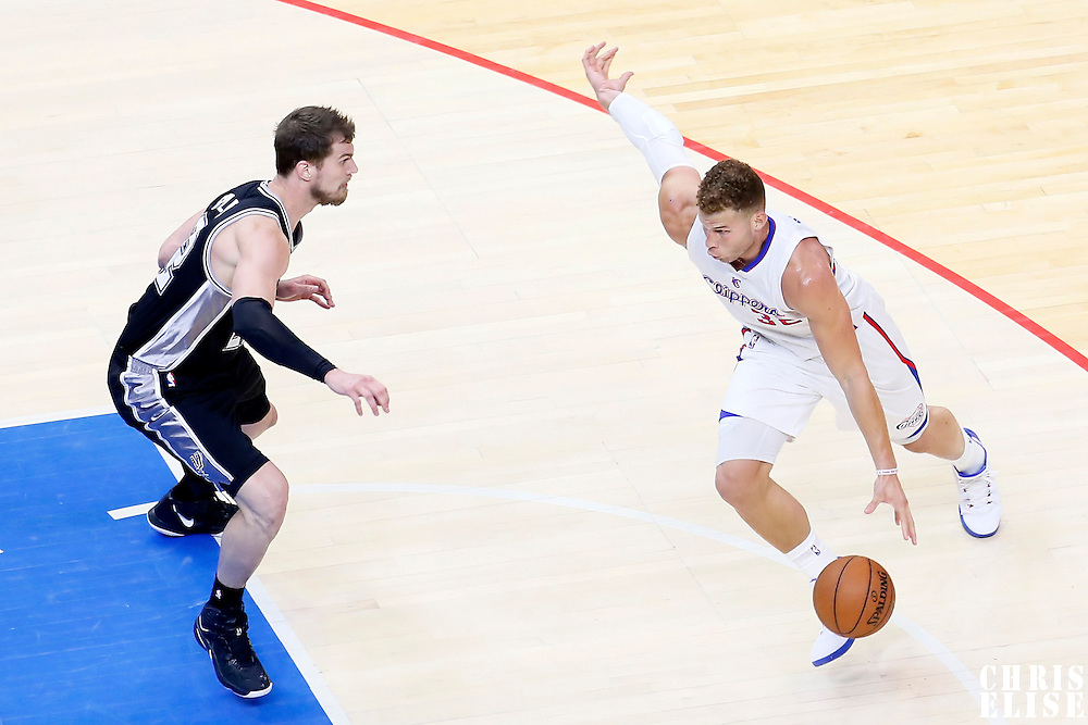 19 April 2014: Los Angeles Clippers forward Blake Griffin (32) drives past San Antonio Spurs center Tiago Splitter (22) during the Los Angeles Clippers 107-92 victory over the San Antonio Spurs, during Game One of the Western Conference Quarterfinals of the NBA Playoffs, at the Staples Center, Los Angeles, California, USA.