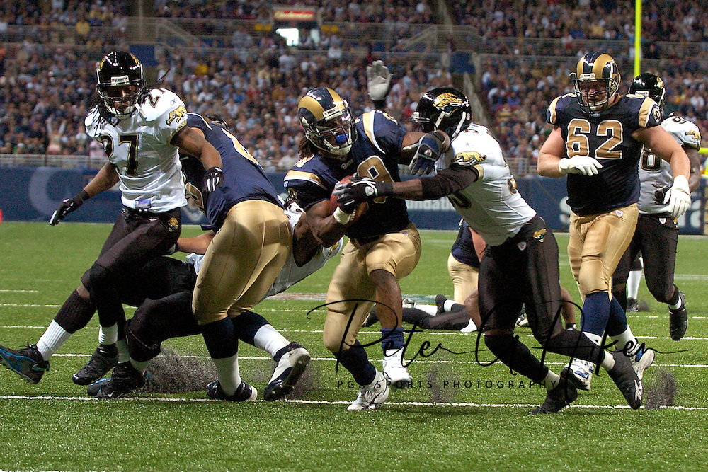 St. Louis Rams running back Steven Jackson (39) fights his way through the Jacksonville defense for a fourth quarter touchdown at the Edward Jones Dome in St. Louis, Missouri, October 30, 2005.  The Rams beat the Jaguars 24-21.