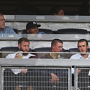 Real Madrid star Gareth Bale, (right), sat in front of Hip Hop star LL Cool, (back row, second left) watching the New York City FC Vs New York Red Bulls, MSL regular season football match at Yankee Stadium, The Bronx, New York,  USA. 28th June 2015. Photo Tim Clayton