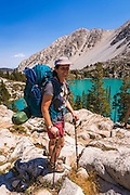 Backpacker at Big Pine Lake #2, John Muir Wilderness, Sierra Nevada Mountains, California USA