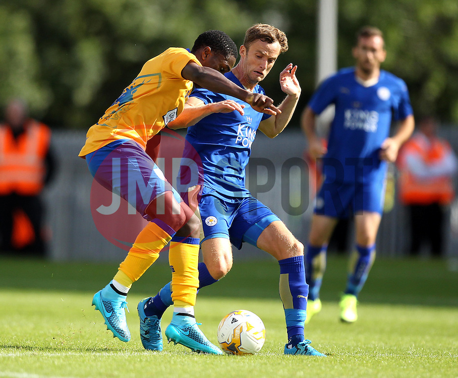 Leicester City's Andy King tackles Mansfield Town's Mitchell Rose - Mandatory by-line: Robbie Stephenson/JMP - 25/07/2015 - SPORT - FOOTBALL - Mansfield,England - Field Mill - Mansfield Town v Leicester City - Pre-Season Friendly