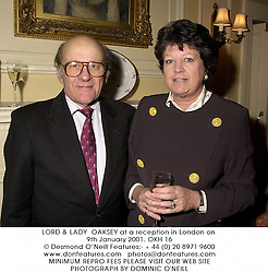 LORD & LADY  OAKSEY at a reception in London on 9th January 2001.	OKH 16