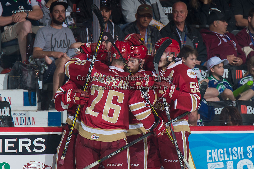 REGINA, SK - MAY 19: Olivier Galipeau #26 and Jeffrey Truchon-Viel #25 of Acadie-Bathurst Titan celebrate a goal against the Swift Current Broncos at the Brandt Centre on May 19, 2018 in Regina, Canada. (Photo by Marissa Baecker/CHL Images)