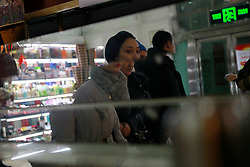 An ethnic Uighur woman is reflected in a mirror in the Dabazha or Grand Bazaar in Urumqi city, Xinjiang Uighur Autonomous Province, China, 16 November 2017. Uighurs, a Muslim ethnic minority group in China, make up about 40 per cent of the 21.8 million people in Xinjiang, a vast, ethnically divided region that borders Pakistan, Afghanistan, Kazakhstan, Kyrgyzstan and Mongolia. Other ethnic minorities living in here include the Han Chinese, Kyrgyz, Mongolian and Tajiks people. Xinjiang has long been subjected to separatists unrests and violent terrorist attacks blamed by authorities on Islamist extremism while human rights groups say Chinese repression on religious rights, culture and freedom of movement caused undue tensions. Life however goes on under the watchful eye of the government for the ethnic Uighurs living in the city of Urumqi and surrounding areas and the region is still considered an attractive tourist spot. A recent report by state media Xinhua news agency claims Xinjiang received more than 100 million tourists in 2017, 'the highest figure in its history'.