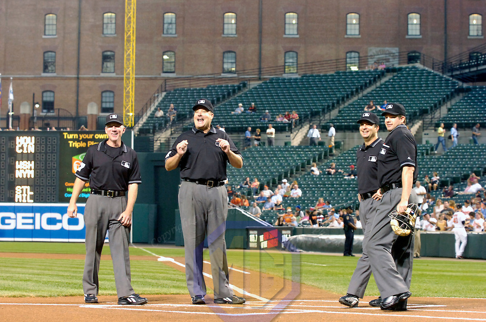 25 September 2007:  Umpires (L-R) Lance Barksdale, Gary Cedestrom, Jim Reynolds and Adam Dowdy stand at home plate at the start of the game between the Toronto Blue Jays and the Baltimore Orioles.  The Blue Jays defeated the Orioles 11-4 at Camden Yards in Baltimore, MD.  ****For Editorial Use Only****