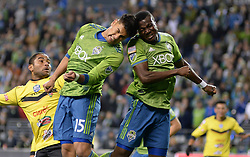 March 1, 2018 - Seattle, Washington, U.S - Soccer 2018: Seattle's TONY ALFARO (15) and NOUHOU (5) hit heads as they defend against a corner kick as Santa Tecla FC visits the Seattle Sounders for a CONCACAF match at Century Link Field in Seattle, WA. (Credit Image: © Jeff Halstead via ZUMA Wire)