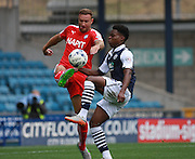 Chesterfield player Ian Evatt and Millwall player Fred Onyedinme tussle for possession during the Sky Bet League 1 match between Millwall and Chesterfield at The Den, London, England on 29 August 2015. Photo by Bennett Dean.