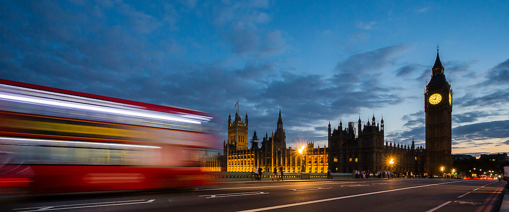 Red buses pass through Westminster Bridge all the time, with the iconic Big Ben and Houses of Parliament in the background