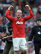 Wayne Rooney Celebrates towards the Man United fans after the final whistle.Manchester United 2010/11 .Manchester United V Chelsea (2-1) 08/05/11 at Old Trafford.