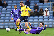 Shrewsbury Town midfielder Luke Goss (22) slides in to tackle Oxford United midfielder James Henry (17) during the EFL Sky Bet League 1 match between Oxford United and Shrewsbury Town at the Kassam Stadium, Oxford, England on 7 December 2019.