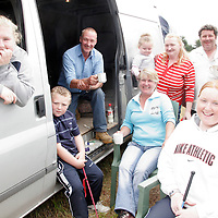 The Riordan, Sherlock and Ryan family enjoy a cup of tea at the Spancilhill Horse Fair on Friday.<br />