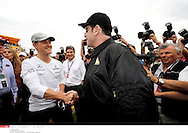 Grand Prix d'Australie de formule 1..Melbourne 28 mars 2010..avant course. ..Photo: Stéphane Mantey/ L'Equipe *** Local Caption *** travolta (john)..schumacher (michael)