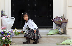 A young  girl  lays a flower outside Baroness Thatcher's house in London, Wednesday, 10th April 2013 Photo by: Stephen Lock / i-Images<br /> <br /> File photo - One year ago: Baroness Thatcher died.<br /> On Tue, Apr 8 2014 it will be one year since the Longest-serving UK Prime Minister of the 20th century, the first and only woman to serve in the role to date, died on April 8, 2013  after suffering a stroke.